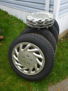 Set of 4 Blizzak Winter Tires on Rims 205 65 16