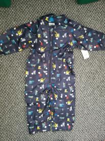 Brand new onesie rain suit/ puddle suit