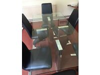 Glass table and leather/chrome chairs for sale