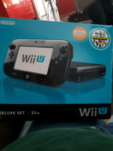 Black Wiiu with box and original cords.