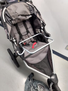 Bob stroller with carseat bracket cup holder and rain cover.