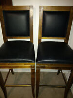 Two Black and Tan Barstools