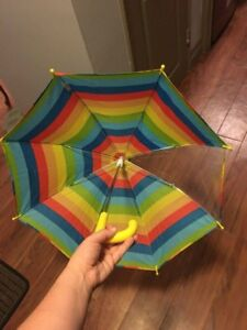 Colourful umbrella with see through panel. Brand new
