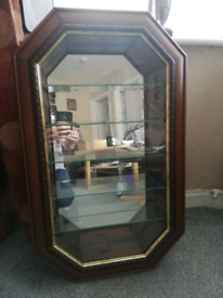 A WOODEN DISPLAY CABINET WITH 5 GLASS SHELFS.