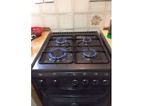 Gas cooker with 4 burners and double compartment
