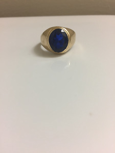 Selling 14k solid gold with sapphire stone