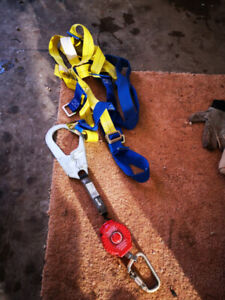 Harness and retractable lanyard 6ft I believe