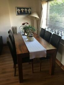 solid wood dining table with 8 leather chairs