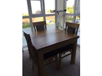 Oak dining table extendable and four chairs