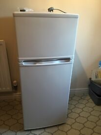 Currys Essentials white fridge freezer.