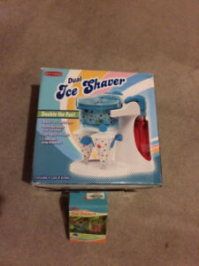 Dual snow cone maker and cup holders
