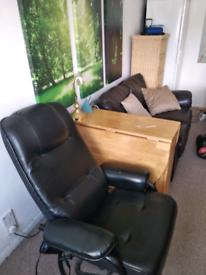 Inclining massage armchair