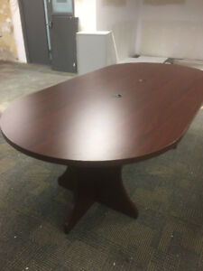 12 ft by 4ft wooden oval table with a hole for cords.