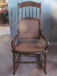 Vintage rocking chair with cane seat and back $119