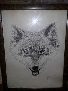 Framed wolf painting
