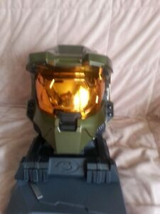 Halo Master Chiefs Helmet,and stand,collectors video set,more