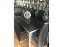 Stunning black and Polished Steel/Silver Dining Set