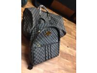 Louis Vuitton backpack and gym bag
