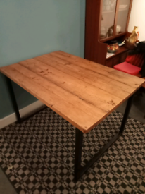Reclaimed wood industrial-style dining table