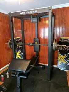 Gold's gym Smith machine and bench.