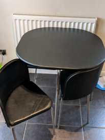 Amparo Dining Table and 4 chairs.
