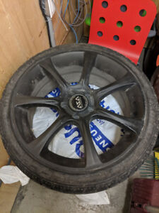 225/40R18 winter radials with black ASA mags