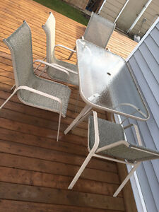 Glass/Metal table with 4 chairs (Oakburn, MB)
