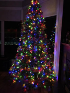 9 FT PRELIT CHRISTMAS TREE (clear or multi)