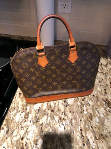 LOUIS VUITTON MONOGRAM ALMA WITH LOCK AND KEY only$450