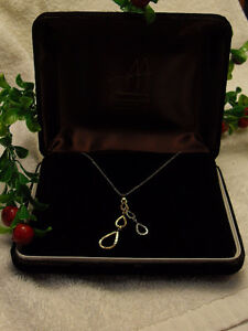 14kt white gold necklace with 16 inch chain/14kt gold pendant