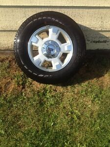 A set of 4 stock tires and rims For a Ford f150