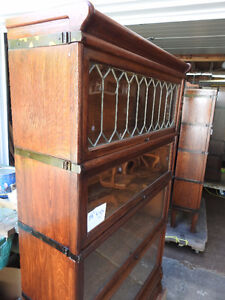 antique barrister bookcase with leaded top section.. restored