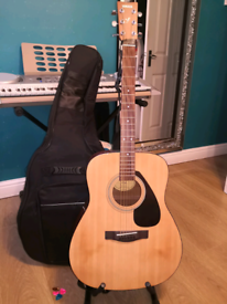 Yamaha F310 acoustic guitar, Case & stand