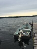 Fishing boat with trailer for sale.