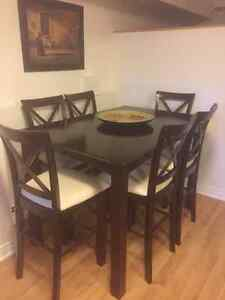 Solid cherry wood bar height dinning table and six chairs