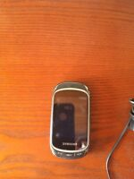 Samsung Galaxy with charger and purple case