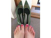 Well worn green kitten heels