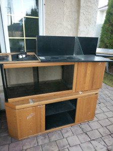 Full wooden entertainment unit with light and glass shelves