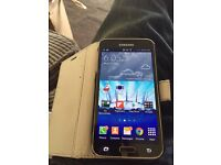Samsung s5 gold with case and sd card