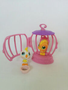 Littlest Pet Shops group of 2 birds, cage and seeds, by Hasbro