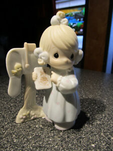 """""""Sharing The Good News Together"""" Precious Moments figurine."""