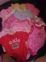 Bag full of infant girl clothes