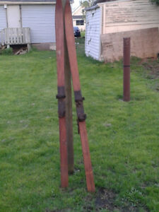 Two pairs of wooden antique skis for sale. $100.00 each pair.