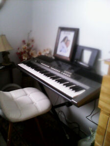 Yamaha portable keyboard with stage stand