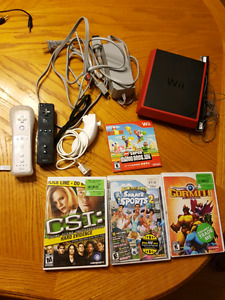 Red wii with 4 games and 2 controllers