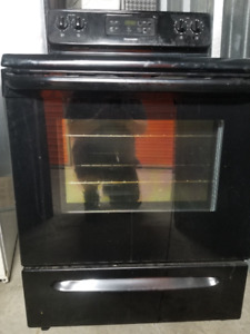 Selling a glasstop black stove, less than 5 yrs old.