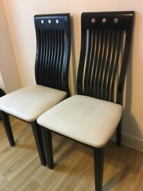Pair of used solid wood chairs