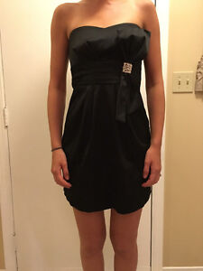 15. Beautiful black dress with side bow