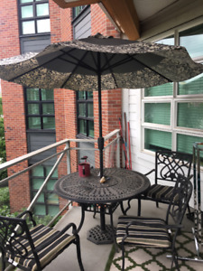 Cast Iron Table with Umbrella and 4 Chairs