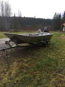 New welded aluminum river boat with outboard jet on trailer